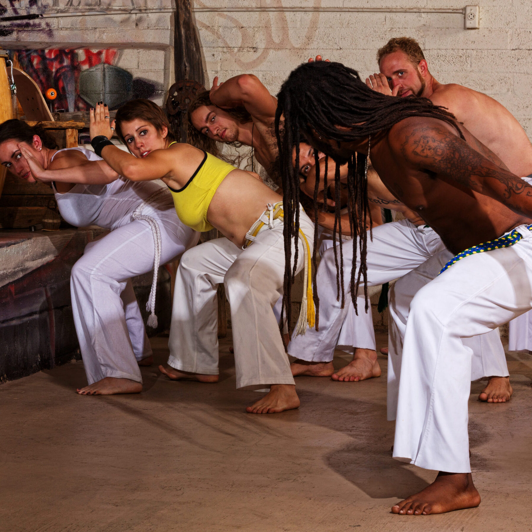 Group of capoeira students with master teacher